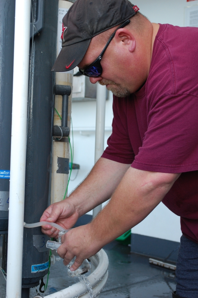 Collecting a sample from Niskin bottles on the CTD rosette
