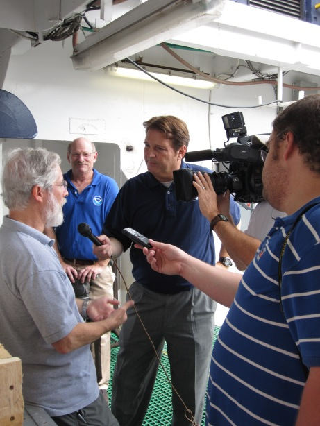 Chief Scientist Ian Hartwell talks to reporters about the sediment sampling the team will perform