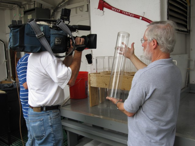 Chief Scientist Ian Hartwell shows reporters one of eight chambers from the multi-corer used to collect sediment from the ocean floor
