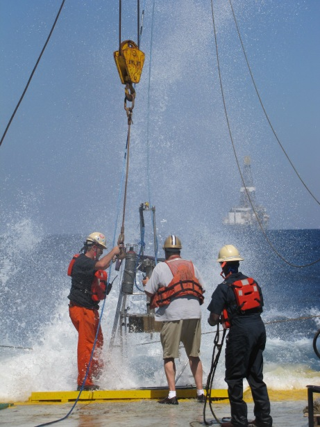Crew members get soaked as we pull the multi-corer in from a sample drop.