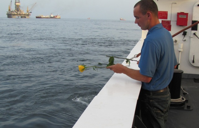 Ryan Harris performs memorial service near the Deepwater Horizon site