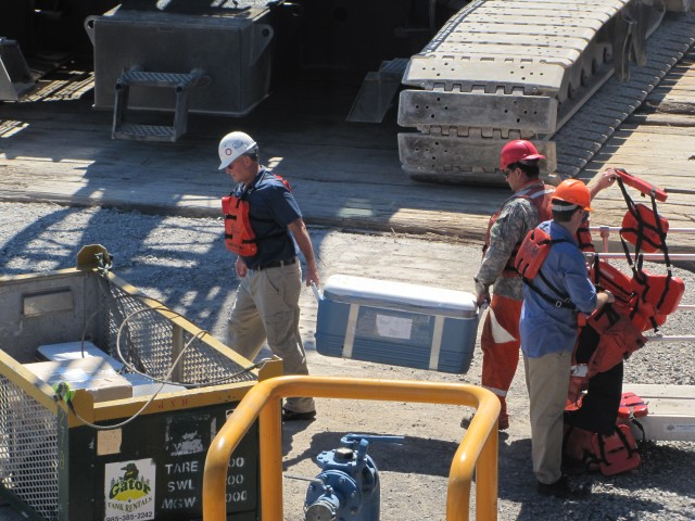 Samples being carried off the ship in a cooler